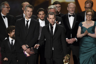 David Benioff, centre left, and DB Weiss accept the award for outstanding drama series for Game Of Thrones at last month's Emmy Awards.