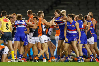 Bulldogs and Giants players wrestle during an all-in melee on Friday night.