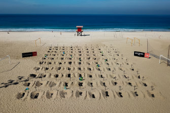 An aerial view of symbolic graves on the beach.