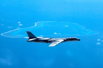 A Chinese H-6K bomber patrols the islands and reefs in the South China Sea.