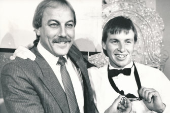 Paul Couch proudly displays the 1989 Brownlow Medal, with some help from his Cats coach Malcolm Blight.