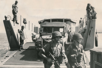 Australian troops and vehicles disembark in Vietnam in 1965.