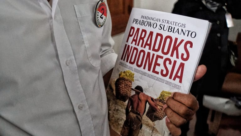 A Prabowo supporter carried his latest book 'Paradox Indonesia'.