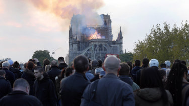 People broke out in song as flames engulfed Notre-Dame Cathedral.