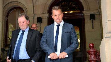 Ex-AFL star Glenn Archer (right) leaves the Supreme Court on Friday.