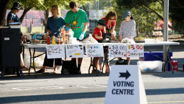 Election day in Australia is accompanied by cake stalls and sausage sizzles to raise funds for schools and other community groups.