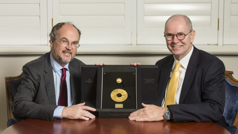 Minister for Mines and Petroleum Bill Johnston and The Perth Mint CEO Richard Hayes with the coin.