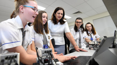 Queensland Premier Annastacia Palaszczuk (centre) visits the Bremer State High School in Ipswich, west of Brisbane.