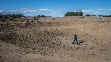 Bedervale in Braidwood farmer Mark Horan walking through one of the 20 dried dams on his property.