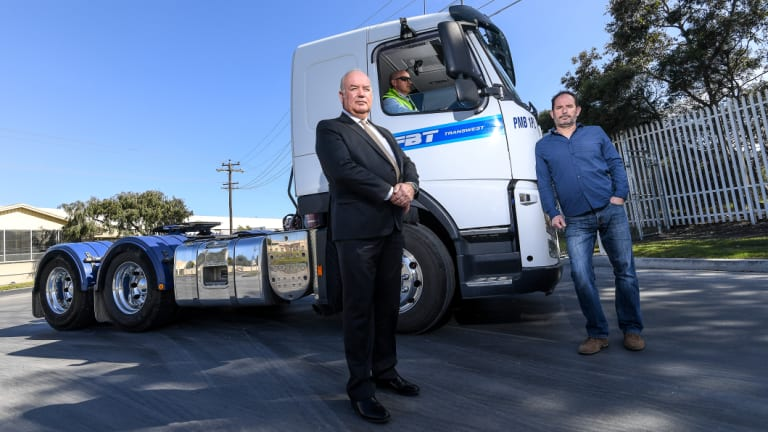 Victorian Transport Association chief executive Peter Anderson (left) and Maribyrnong Action Transport Group secretary Martin Wurt with a new truck equipped with a Euro 5 engine.