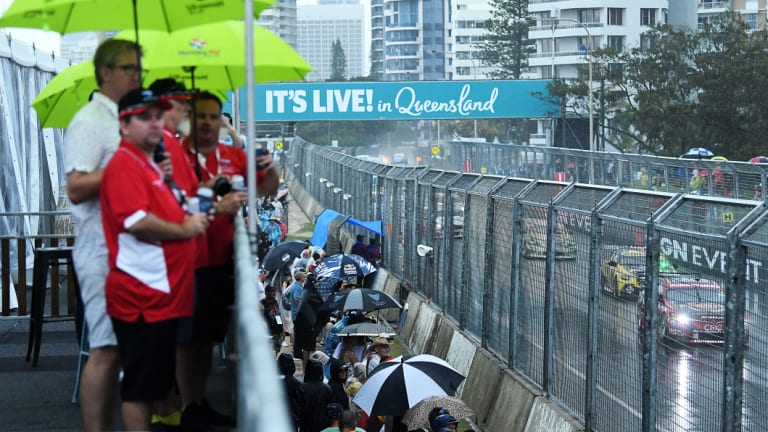 Rain on the parade: Gold Coast crowds take cover amid the downpour.