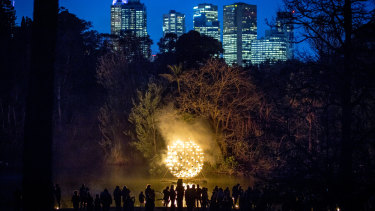 A spherical frame holds dozens of fire pots.