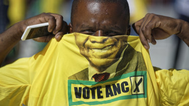 A supporter of the ruling African National Congress (ANC) in a President Cyril Ramaphosa T-shirt at an election rally at Ellis Park in Johannesburg on Sunday.