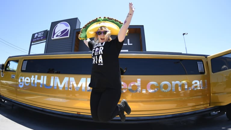 Ashlea Russell in her giant Taco hat before she is driven back to Brisbane Airport in a stretch limousine.