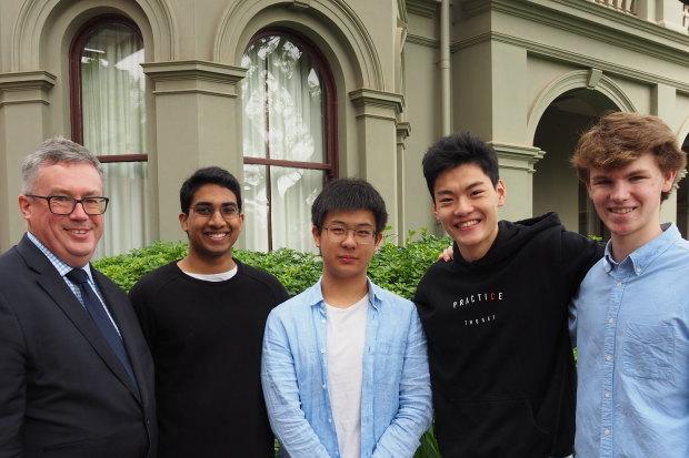 Camberwell Grammar studentsJames Gunasegaram, Ian Chen, Andrew Zeng, and Lachlan Doig each achieved an ATAR of 99.95. They're with headmaster Paul Hicks.