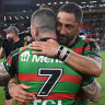 Benji Marshall and Adam Reynolds embrace after securing their plave in the grand final.