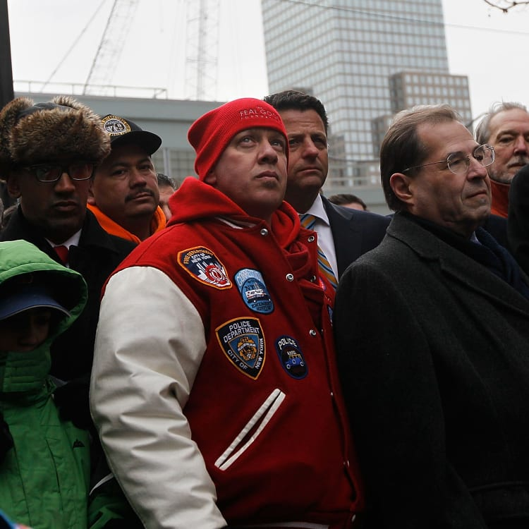 John Feal (in red) at New York's Ground Zero during a press conference to celebrate the passage of a 9/11 workers health care bill.