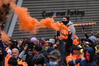 Protesters set off flares in the city.