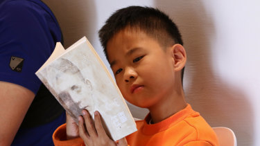 """A boy reading """"Once"""", a book by  Morris Gleitzman at Beijing Happy Space."""