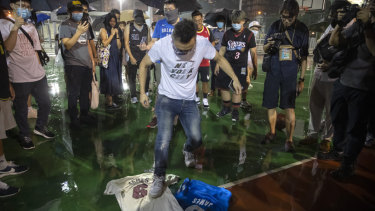 A demonstrator stomps on a LeBron James jersey during the rally.