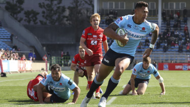 Prolific: Folau crosses in the first half as he edges towards a new record.