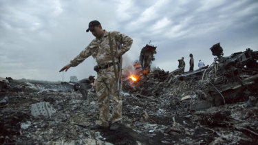 Officers at the MH17 crash site in Ukraine.