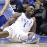 Zion Williamson grimaces after falling to the floor during the first quarter of the Duke-North Carolina clash.