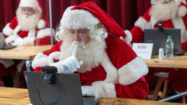 A Santa comes to grips with video technology during a Ministry of Fun training course in London.