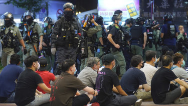 Hong Kong police detain people protesting against the new security law during in July.