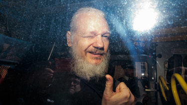 Julian Assange gestures to media from a police vehicle on his arrival at Westminster Magistrates court in April. The Ecuadorian Embassy in Central London had withdrawn his asylum after seven years.