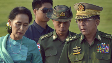 Aung San Suu Kyi, left, Myanmar's then foreign minister, walks with Senior General Min Aung Hlaing, right, in 2016