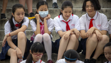 Beijing says the new rules will reduce the financial burden of education on parents.