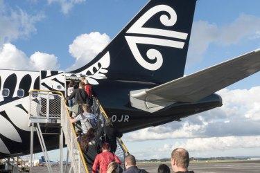 <p>Auckland, New Zealand &#8211; May 29, 2015: Air New Zealand Flight 455 passengers boarding, departing for Wellington New Zealand</p>