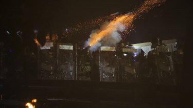 Riot police fire tear gas during clashes with students at the Chinese University in Hong Kong.