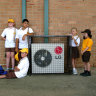 Sweltering schools forced to wait for network upgrades before they turn on aircon