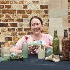 Urbis archeologist Holly Maclean with some artefacts found at the $3.6 billion Queen's Wharf Brisbane development site.
