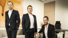 Tim Gurner, right, at his Melbourne office with Qualitas' Mark Fischer, left, and Rohan Davis.