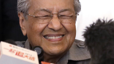 Mahathir Mohamad tells the media he has a clear mandate to form a new government in Malaysia.