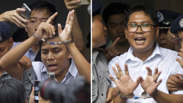 In this combination file image made from two photos, Reuters journalists Kyaw Soe Oo, left, and Wa Lone, are handcuffed as they are escorted by police out of the court in Yangon, Myanmar on September 3.