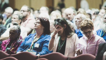 Ms Littlehawk and Ms Kellegher listen to Prime Minister Scott Morrison's apology.