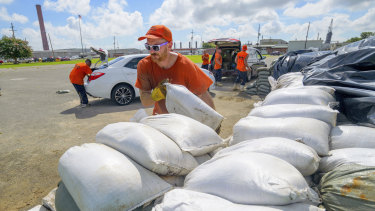 Workers move sandbags for residents in Chalmette, Louisiana, ahead of a possible hurricane.