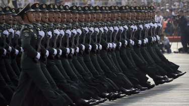 Hong Kong's police and security forces will now march in the goose step used by the well-drilled People's Liberation Army, seen here in 2019 in Beijing.