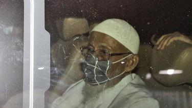 Islamist cleric Abu Bakar Bashir sits inside a van as he leaves Gunung Sindur Prison in Bogor, West Java, Indonesia, on Friday.