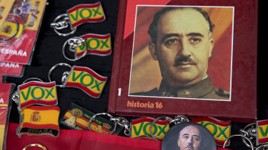 Souvenirs are for sale with Francoist symbology next to key chains of far right wing Vox party during a rally commemorating the 44th anniversary of Spain's former dictator General Francisco Franco's death in Madrid,