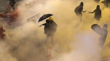 Tear gas is fired at protesters in Hong Kong on Sunday night.