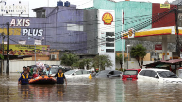 Severe flooding hit Indonesia's capital as residents were celebrating New Year's Eve. More extreme weather is forecast.