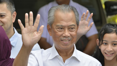 Malaysia's Prime Minister Muhyiddin Yassin looks set to hold on to power - at least for now.