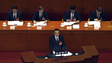 Chinese Premier Li Keqiang delivers a speech during the opening session of China's National People's Congress (NPC) at the Great Hall of the People in Beijing.