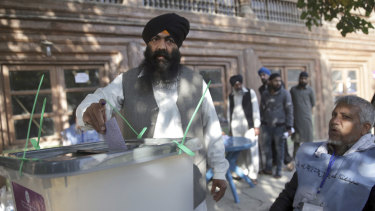 A man from the minority Sikh casts his vote in Parliamentary elections in old city of Kabul, Afghanistan, on Saturday.