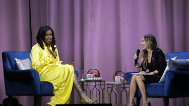 "Former first lady Michelle Obama (left) is interviewed by Sarah Jessica Parker during an appearance for her book, ""Becoming: An Intimate Conversation with Michelle Obama""."
